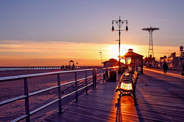 The sun sets over the Coney Island Boardwalk. (Credit: New York Habitat)