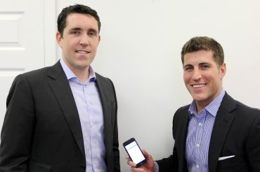 View the Space's Andrew Flint (left), the head of business development, and Ryan Massiello, the chief revenue officer with the new mobile app on his phone