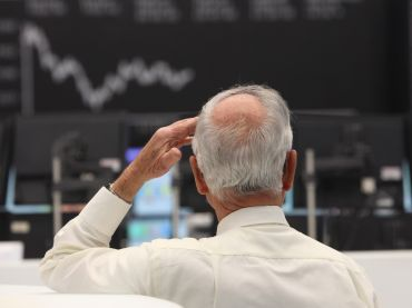 A stock trader at the  Frankfurt Stock Exchange.