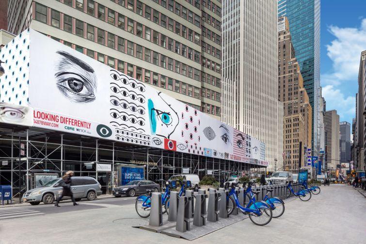Lightstone Group's eye popping scaffolding bridge around 1407 Broadway. (Credit: Evan Joseph)
