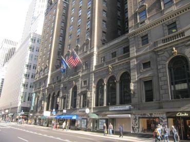 A large hotel along a sidewalk.