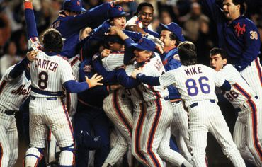 Mets become world champs after winning game 7 of the 1986 World Series against the Boston Red Sox at Shea Stadium. (T.G. Higgins/Getty Images)