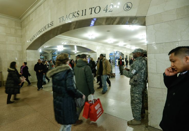 Military officers guard Grand Central Terminal, a potential terrorist target. (Photo by Cem Ozdel/Anadolu Agency/Getty Images)