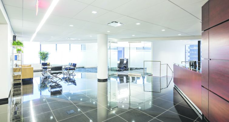 """Black floors off-set the predominantly white design of the office for a clean, and highly modern look. """"It's a beautiful space for lawyers,"""" said Mr. Spector, """"who are not used to beautiful space."""" (Photo: Ben Gancsos)"""