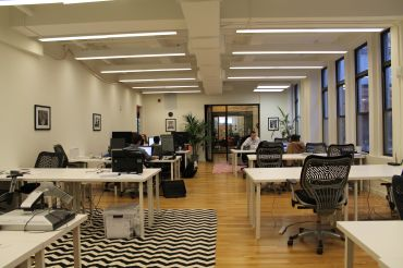 One of the shared space companies taking NYC is PivotDesk.