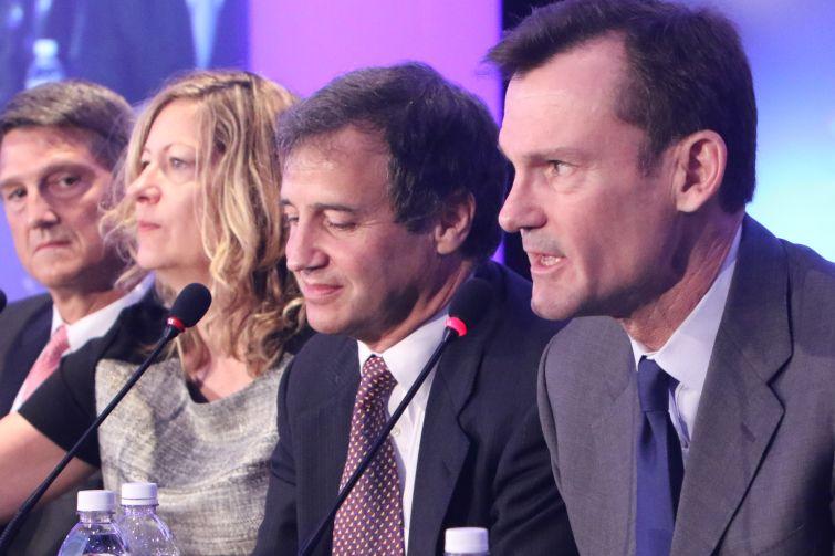 A group of panelists speak at CREFC.