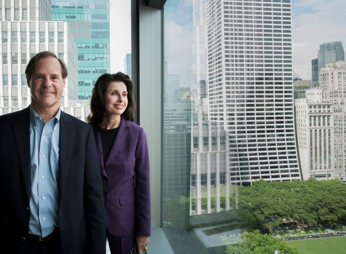 Tommy Craig and Mary Ann in front the 10th floor view from 7 Bryant Park (Photo: Sasha Mazlov/For Commercial Observer).