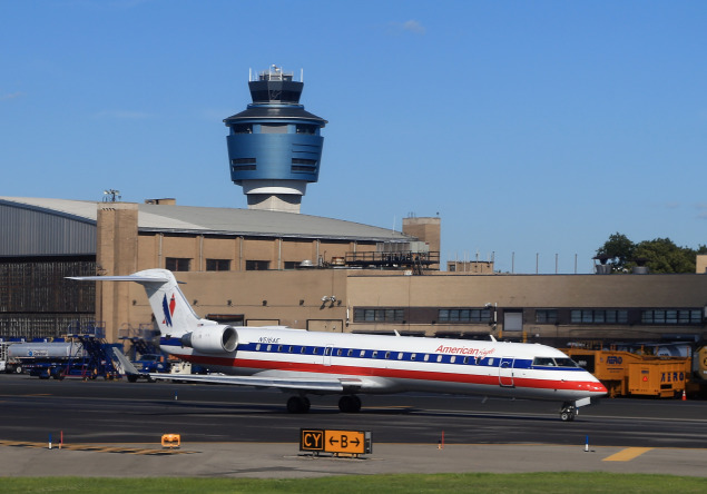 An American Airlines jet taxis on the runway of LaGuardia Airport (Photo: Bruce Bennett/Getty Images).