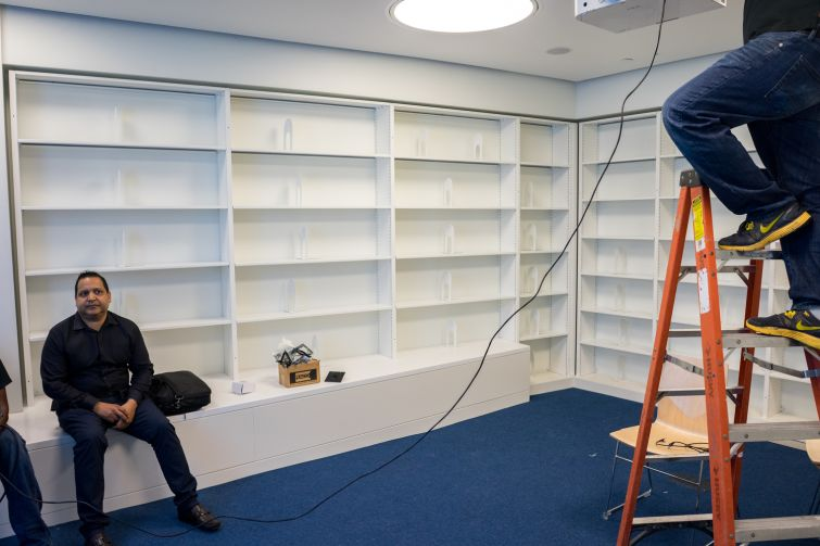 Men working on finishing details in the library (Photo: Jake Naughton).