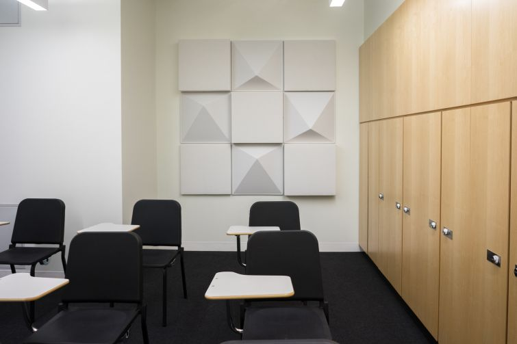 The chamber ensemble room, complete with storage lockers and acoustic tiles (Photo: Jake Naughton).
