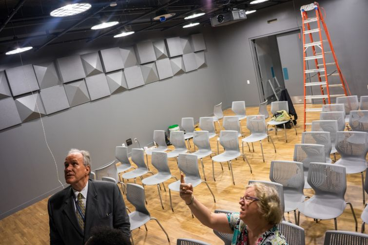David Kleiser, chief financial officer of Brooklyn Friends, and Joan Martin, director of communications, look at details in the upper school's new black box theater, used for small-scale performances of all kinds (Photo: Jake Naughton).