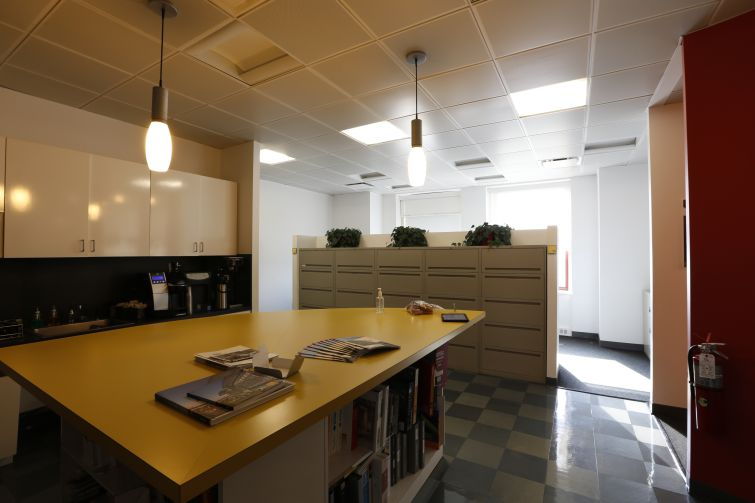 The revitalization will focus on bringing more light into the office. This is a picture of the current pantry (Photo: Corgan).