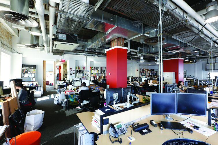 Existing workstations at Corgan's office (Photo: Corgan).