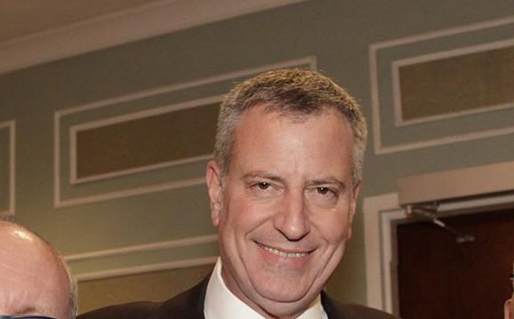 Cushman & Wakefield's Bruce Mosler, left, Mayor Bill de Blasio, center, and REBNY President John Banks.
