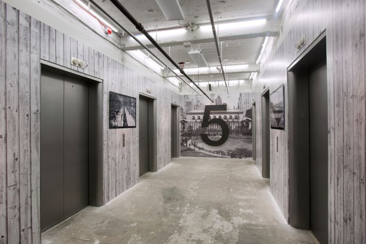The elevator area of the ninth floor was covered with faux-wood wallpaper (Photo: Kevin Chu and Sharon Mclaughlin).