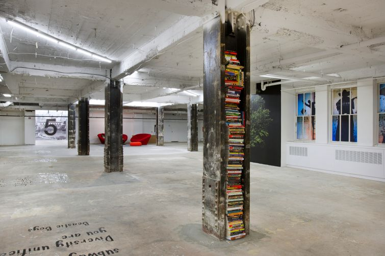 For a more gritty feeling on the ninth floor, columns were stripped down to the steel and books filled in the empty spaces (Photo: Kevin Chu and Sharon Mclaughlin).