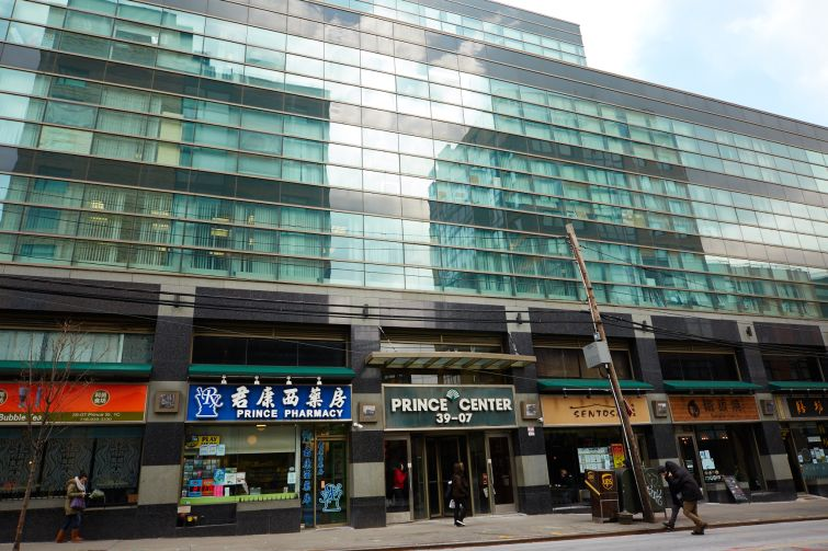Messrs. Lee and Chiu built the retail and office condo Prince Center in 2002 (Photo: Yvonne Albinowski/ For Commercial Observer).