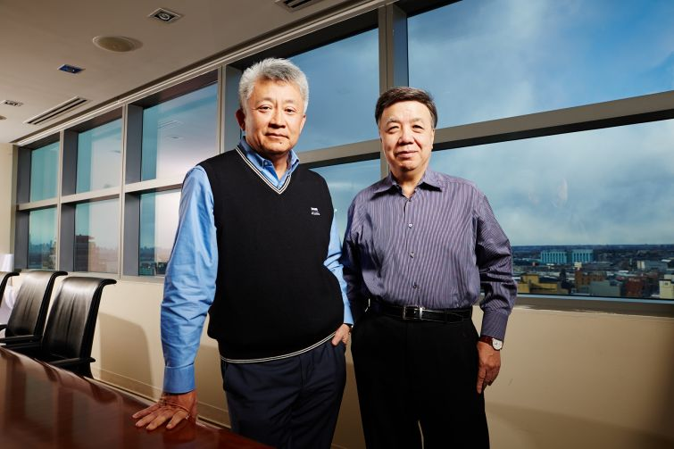 Sunny Chiu and Michael Lee in their offices in Flushing (Photo: Yvonne Albinowski/ For Commercial Observer).