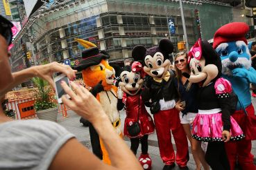 Legislation to regulate pedestrian plazas congregated by costumed characters in Times Square  would have to come soon, according to the district business improvement group (Photo: Spencer Platt/Getty Images).