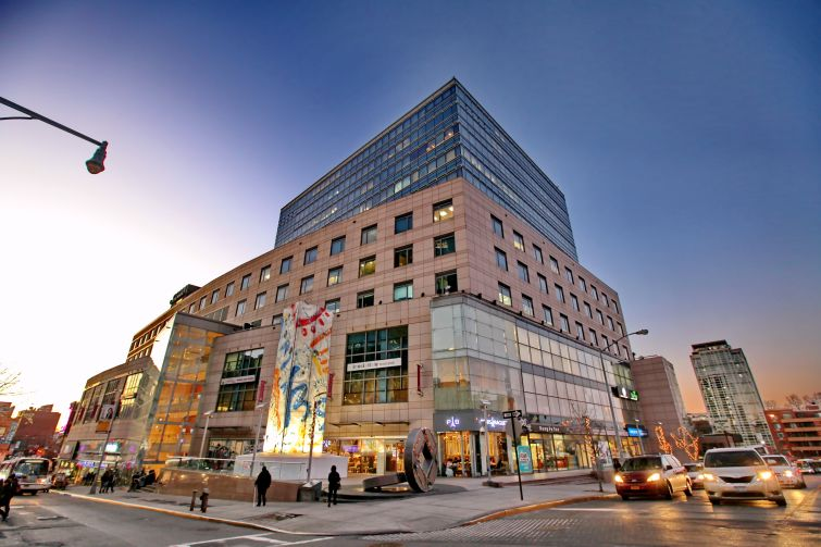Messrs. Lee and Chiu built Flushing's first Class A building, Queens Crossing, at 136-20 38th Avenue (Photo: F & T Group).