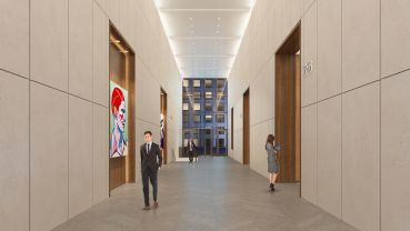 The lobby's dated granite will be swapped for limestone (Rendering: Real Estate Arts).