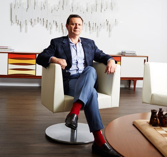 S. Lawrence Davis, CEO of Shorewood Real Estate Group, in his office at 40 Wall Street (Photo: Yvonne Albinowski/ For Commercial Observer).
