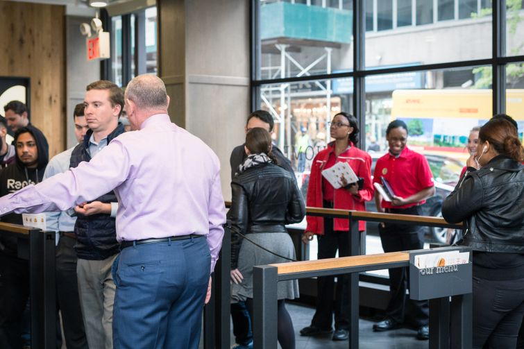 Franchisee owner Oscar Fittipaldi directs the line at his Chick-fil-A at 1000 Avenue of the Americas (Photo: Kaitlyn Flannagan/Commercial Observer).