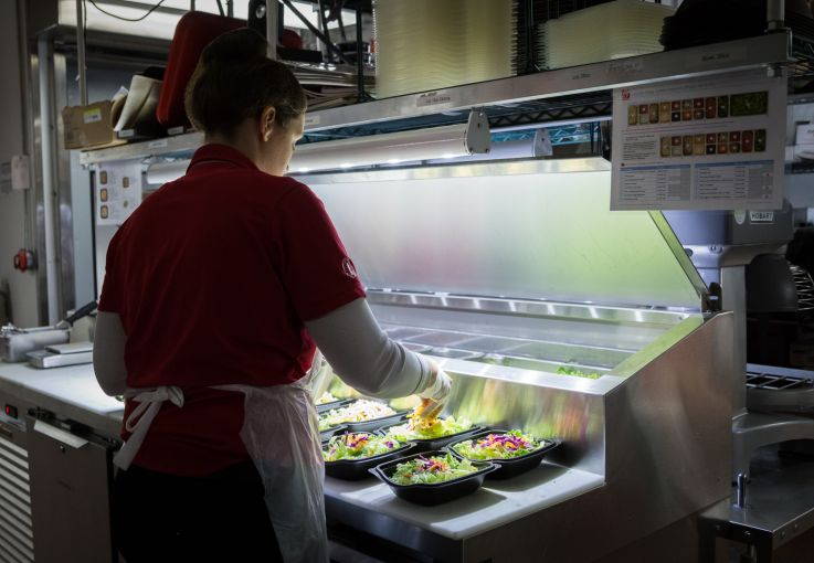 Employee makes salad in the basement kitchen of Chick-fil-A at 1000 Avenue of the Americas (Photo: Kaitlyn Flannagan/Commercial Observer).