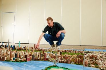 Joe Macken with his mini-Manhattan structure (Photo: Yvonne Albinowski/ For Commercial Observer).
