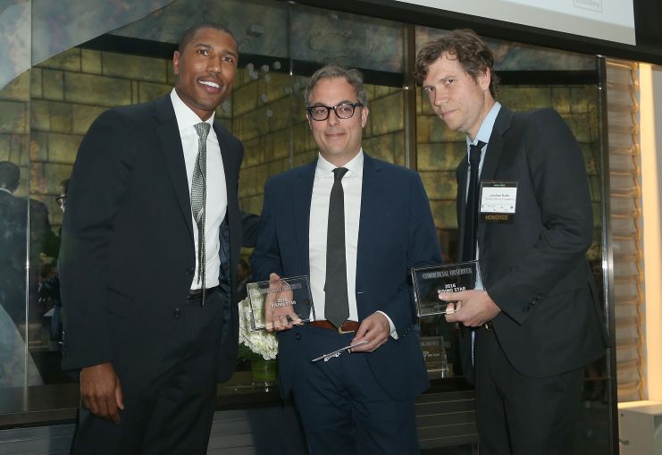 Chad Tredway of Chase presents the Rising Stars of the Year award to Eric Demby and Jonathan Butler of Smorgasburg (Photo: Jimi Celeste/PMC).