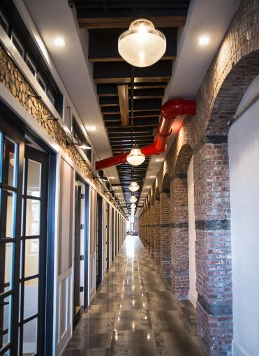 The shared corridor features industrial features like brick arches (Photo: Kaitlyn Flannagan /for Observer).