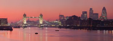The sun sets over the Thames in London.