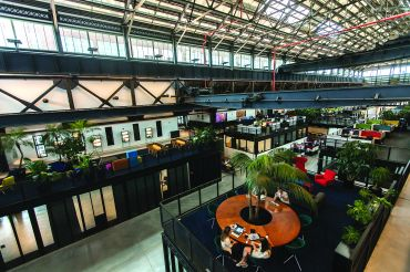 A view of the communal work and meeeting spaces at New Lab in Brooklyn. Photo: Emily Assiran/Commercial Observer