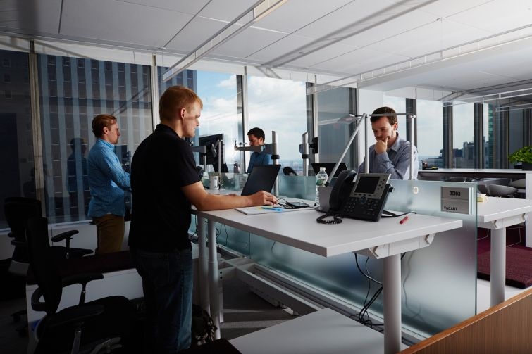 Standing desks help workers maintain healthy bodies. Photo: Yvonne Albinowski/For Commercial Observer