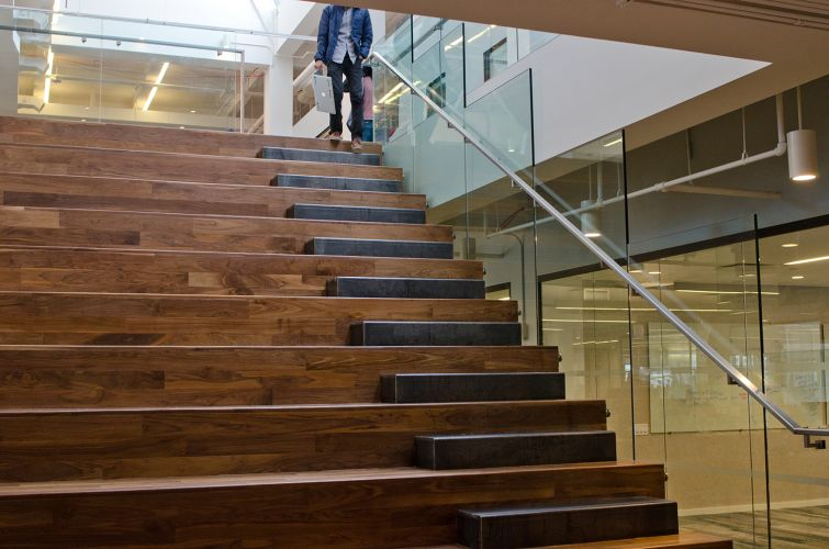 Yodle's interconnected staircase is part of a modern, open office, which features desks with treadmills in its latest expansion. Photo: Molly Stromoski For Commercial Observer.