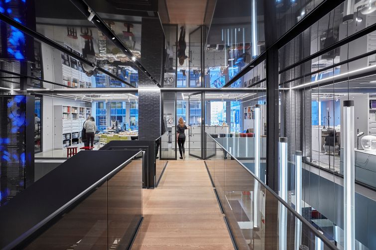 There are wood floors and mirrors incorporated in the office build-out. Photo: Gensler.