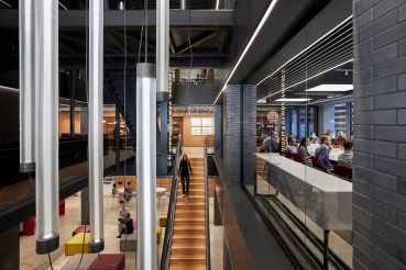 Gensler's new office features a center staircase that connects its floors. Photo: Gensler;