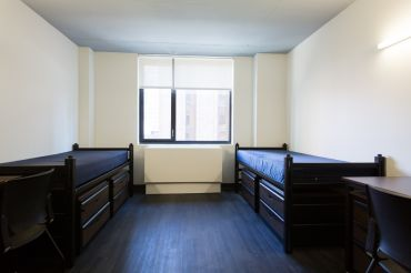 A room in the dorm at 340 East 24th Street.
