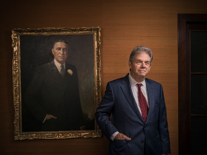 Steven Kaufman stands in front of a portraiit of his late grandfather, Samuel Kaufman. Photo: Sasha Maslov.