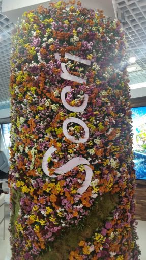 A Socri live flower- and grass-decorated pole at MAPIC. Photo: Lauren Elkies Schram.