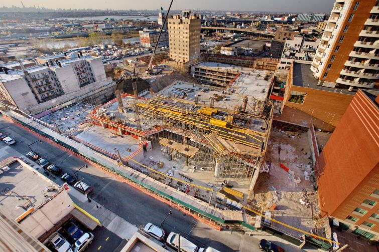 F&T Group's Tangram project, a 1.2-million-square-foot development in Flushing under construction, will bring the neighborhood's first movie theater in three decades in a 225,000-square-foot retail podium. Photo: F&T Group.