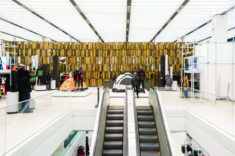 A nearly floor-to-ceiling brass art work hangs in The North Face's space.  Photo by Eugene Gologursky/Getty Images for The North Face.