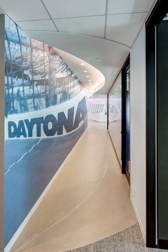 In the hallway, there is a photo of the Daytona International Speedway.