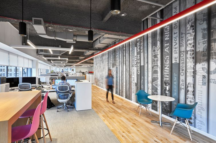 The office has open layout with exposed ceilings. Photo: Garrett Rowland.