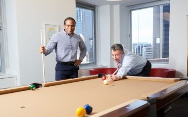 Liam and Jon Mechanic playing pool at Fried Frank's office in 1 New York Plaza. Photo: Yvonne Albinowski/For Commercial Observer