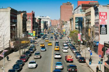 Looking west on Harlem's 125th Street from the Metro North station. Photo: Getty Images.