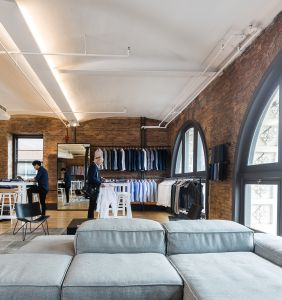 Online custom dress shirt maker Proper Cloth's new office and showroom has exposed brick walls. Photo: Emily Assiran/For Commercial Observer