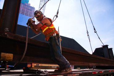 New York City ironworker readies steel for crane lift. Photo Courtesy of Joe Woolhead