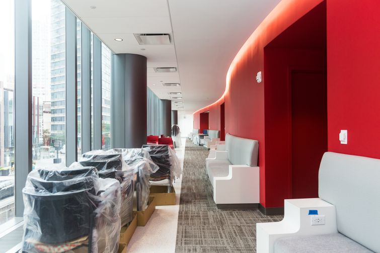 Red exterior hallways at the new Brooklyn Health Center. Photo: Emily Assiran/For Commercial Observer