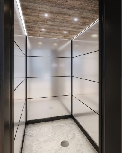 The landlords have installed 11 new elevators with marble floors, glass walls and white oak ceilings. Rendering: Cove Property Group